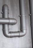 Plastikwasserleitung auf der Wand Lizenzfreies Stockbild