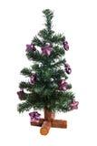 Plastikweihnachtsbaum mit purpurroten Sternen Lizenzfreie Stockbilder