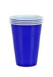 Plastique bleu cupsisolated sur le blanc Photographie stock