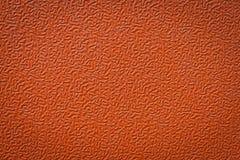 Plastique texturisé orange. Photo stock