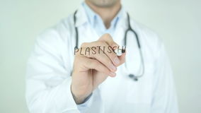 Plastische Chirurgie, Plastic Surgery in German Writing on Glass. Man writing stock video