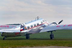 Lockheed Electra 10A vintage airplane preparing for flight on airport. PLASY, CZECH REPUBLIC - APRIL 30: Lockheed Electra 10A vintage airplane preparing for Royalty Free Stock Images