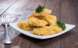 Plat avec des pépites de poulet Photo stock