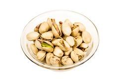 Plat avec des pistaches Photographie stock