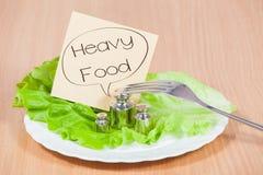 Plat avec le poids Concept de nourriture lourde Photos libres de droits