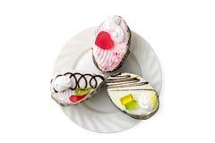 Plat avec 3 types de gâteaux Image stock
