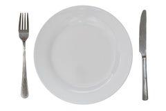 plat avec vide de fourchette et de couteau d'isolement Images stock