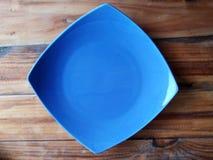 Plat bleu images stock
