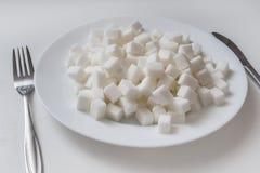 Plat complètement de cubec de sucre Concept malsain de consommation photos libres de droits