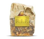Plat d'or avec le texte de DÉCHIRURE sur la grande roche Photo stock