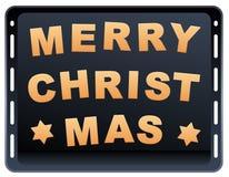Plat de cuisson de Joyeux Noël de biscuits Image stock