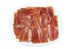 Plat de jambon espagnol de serrano sur le fond blanc Photo stock