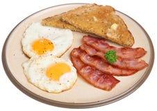 Plat de lard et de petit déjeuner d'oeufs d'isolement image stock