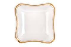 Plat de vintage de forme peu commune avec la jante d'or d'isolement Vue supérieure de cuvette Image libre de droits
