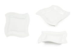 Plat en céramique blanc d'isolement photo stock