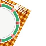 Plat et fourchette sur une serviette Photo stock