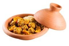 Plat traditionnel de Tajine des boulettes de viande et du couscous photographie stock libre de droits
