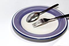 Plat vide avec la cuillère et la fourchette Photographie stock