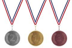 Plata del oro y medallas de bronce Foto de archivo libre de regalías