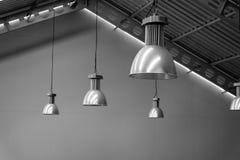 Plata grande de la lámpara en fábrica del techo Foto de archivo libre de regalías