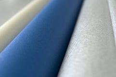 Plata, oro y azul Rolls Fotos de archivo libres de regalías
