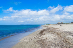 Platamona shore under clouds Stock Photo