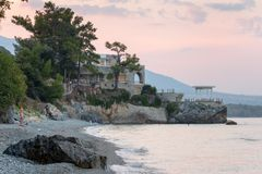 PLATAMONAS, GREECE - AUGUST 30, 2018 :View of the famous Villa Moskoff from the shore royalty free stock photo