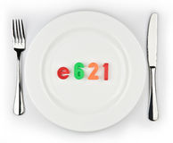Plate. E621-unhealthy nutritional taste enhancer delivered in a plate Royalty Free Stock Photos