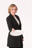 Plate #3. Business woman handing out empty plate Stock Photo