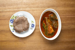 A plate of amala served with ewedu,gbegiri, titus fish and pieces of beef stock photos