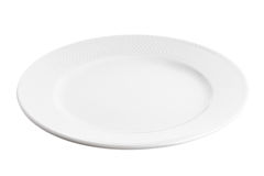Plate at angle. White plate at angle isolated on white background Royalty Free Stock Images