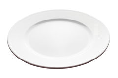 Plate - angle view. White plate isolated on white background (angle view, deep depth of field, picture is in focus from front to back Royalty Free Stock Image
