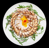 Plate with appetizer, isolated on black Stock Image