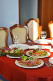 Plate with appetizers on the dinner table. Plates with appetizers on the dinner table Stock Photo