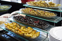 Plate of appetizers - olives and green hot pepper Stock Photos