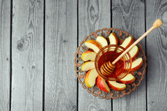 Plate with apple and honey for Jewish Holiday Rosh Hashana (New Year). View from above with copy space Royalty Free Stock Photography