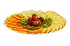 Plate apple kiwi food grapes sliced isolated on Stock Photos