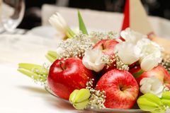 Plate of apples. With flowers on the table on Wedding Royalty Free Stock Photography