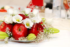 Plate of apples. With flowers on the table on Wedding Royalty Free Stock Image
