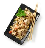 Plate of asian food. Fried rice with chicken and vegetables isolated on white background, top view royalty free stock photos