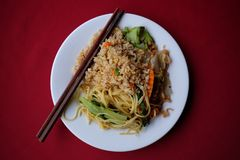 Plate of asian stir fried noodles and stir fried rice stock photo