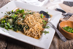 Plate of Asian Stor Fry Noodles. Vegetarian Asian Noodle Stir Fry on white plate Stock Photography