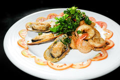 Plate of Asian Style Sesame ginger scallop with hoisin sauce. And Shrimp Skewers in black background royalty free stock image
