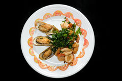 Plate of Asian Style Sesame ginger scallop with hoisin sauce. And Shrimp Skewers in black background stock images