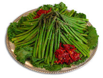 Plate of asparagus. Big plate of asparagus isolated on a white background Royalty Free Stock Image