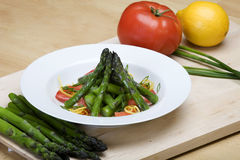 Plate of asparagus and tomato salad Stock Photography