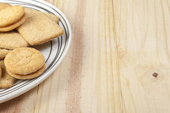 Plate of assorted biscuits on a pine country table Royalty Free Stock Photo