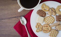 Plate of assorted cookies with a cup of coffee. Royalty Free Stock Photo