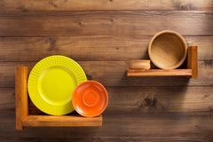 Free Plate At Kitchen Wooden Shelf At Wall Royalty Free Stock Photos - 143588028