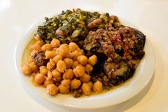 Plate of aubergine moussaka, peas with meat and collard greens. In Black Sea region of Turkey stock photos